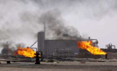 Gas flares are seen at the Rumaila oil refinery, near the city of Basra, 550 kilometers (340 miles) southeast of Baghdad, Iraq.