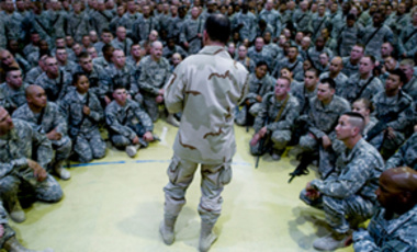 Joint Chiefs of Staff Adm. Chairman Mike Mullen addresses service members in Mosul, Iraq, Aug. 1, 2011. Mullen said Iraq's indecision on asking U.S. troops to stay beyond the end of the year is jeopardizing a smooth withdrawal.