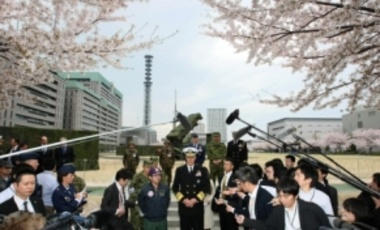Admiral Samuel J. Locklear (C), U.S. Pacific Command, ushered by Shigeru Iwasaki (front L), Chief of Staff of the Joint Staff speaks to reporters after he inspected the launch vehicles for Patriot Advanced Capability-3 missiles in Tokyo, Apr. 11, 2012.