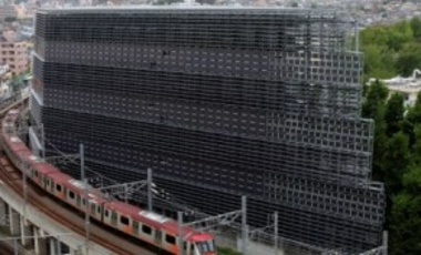 May 1, 2012: A train passes the Tokyo Institute of Technologies' new Environment & Energy Innovation Building, which is covered by 4,500 solar panels. Japan is shutting down its last nuclear reactor, adding urgency to calls for a green energy revolution.