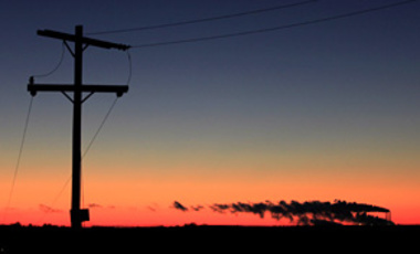 Silhouetted against the sky at dusk, emissions spew from the smokestacks at Westar Energy's Jeffrey Energy Center coal-fired power plant near St. Mary's, Kansas, Sept. 25, 2010.