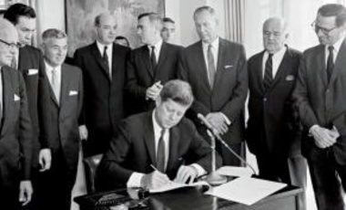 President John F. Kennedy signs the Arms Control and Disarmament Act.