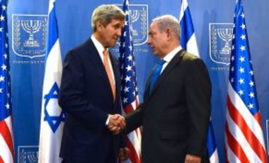 U.S. Secretary of State John Kerry shakes hands with Israeli Prime Minister Benjamin Netanyahu in Tel Aviv, Israel, on July 23, 2014, before the two sat down to discuss a possible cease-fire to stop Israel's fight with Hamas in the Gaza Strip.