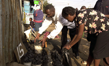A man sells charcoal in Nairobi, Kenya, June 27, 2006. Continued land degradation, wasteful water use, & climate change threaten the livelihoods of more than 70% of Africans.