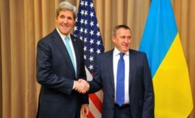 U.S. Secretary of State John Kerry chats with Ukrainian Foreign Minister Andrii Deshchytsia before the two joined with Russian and EU officials for 4-way talks about Ukraine in Geneva, Switzerland, on April 17, 2014.