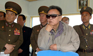 North Korean leader Kim Jong Il, center, watches flight training as he inspects the Korean People's Army Air Force Unit 814 at an unknown location in North Korea.
