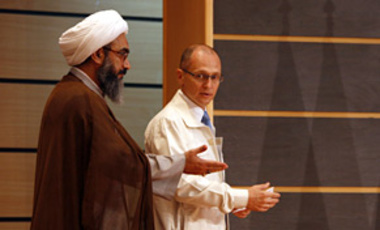 Iranian cleric Gholamali Safaei Bushehri, left, representative of the supreme leader Ayatollah Ali Khamenei, gestures to Russian atomic agency chief Rosatom Sergei Kiriyenko, prior to a press conference at Bushehr nuclear power plant, Aug. 21, 2010.