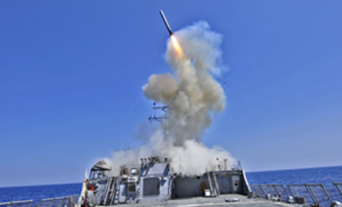 In a Mar. 29, 2011 U.S. Navy photo , the guided-missile destroyer USS Barry launches a Tomahawk cruise missile from the Mediterranean Sea to support U.S. military forces assisting the international response to the unrest in Libya.