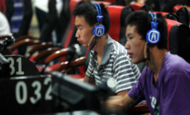Young Chinese netizens play online games and surf the internet at an internet cafe in Guilin city, Guangxi Zhuang Autonomous Region, China, September 29, 2011.
