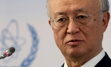 Yukiya Amano addresses the media during a news conference after a meeting of the IAEA board of governors at the International Center in Vienna