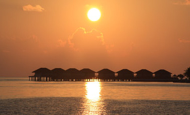 Mar. 25, 2009: Sunset over vacation cottages in the Maldives, an archipelago state of nearly 1,200 islands in the Indian Ocean that would be severely affected by rising sea levels in the coming decades.