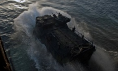 An amphibious assault vehicle exits the well deck of USS Tortuga for a joint amphibious assault exercise with the Royal Malaysian Navy as a part of the exercise Cooperation Afloat Readiness and Training (CARAT) Malaysia 2013.