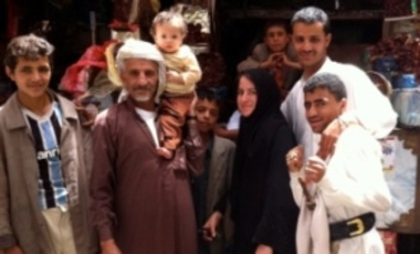 Marisa Porges (center) with locals in the old city of Sana'a, Yemen.