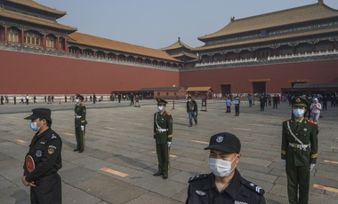 Chinese paramilitary police guarding the entrance to Beijing's Forbidden City as it reopened on Friday to a limited number of visitors.Credit...