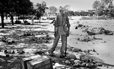 A Moroccan soldier stands guard amid debris on the site of the market in the Grand Place Square in the Medina district of Khenifra, Aug. 26, 1955, resulting from the previous week's bloody riots as French officials, headed by Premier Edgar Faure, struggle