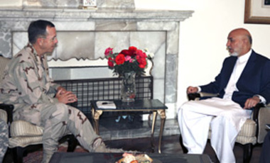 Afghan President Hamid Karzai, right, meets the U.S. military's top officer Adm. Mike Mullen in Kabul, June 26, 2010. Mullen assured Karzai that the new NATO commander will pursue the same war strategy crafted by Gen. Stanley McChrystal.