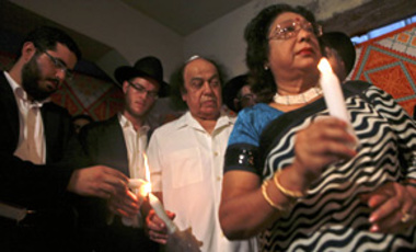 People of various faiths participate in a multi-faith candle light vigil to commemorate the 2008 terror attacks at Nariman House in Mumbai, India, Nov. 17, 2009. Nariman House is the Chabad center that was targeted by the terrorists.