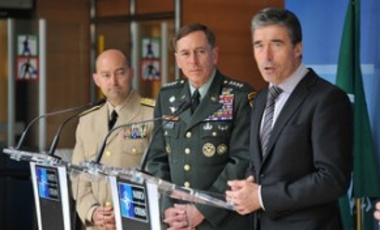 Supreme Allied Commander Europe Admiral James G. Stavridis, General David H. Petraeus (new Commander of ISAF) and NATO Secretary General Anders Fogh Rasmussen during a news conference at NATO Headquarters, July 1, 2010.