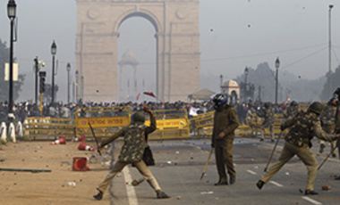 Indian protesters and policemen throw stones at each other during a protest in New Delhi, India, December 23, 2012.