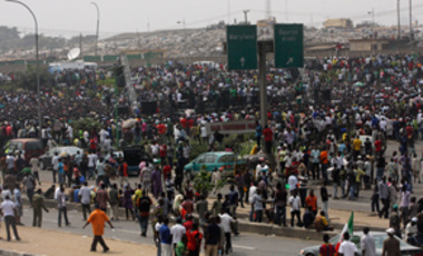 Protesters gather at Gani Fawehinmi Park as a national strike over fuel prices and government corruption entered its 2nd day in Lagos, Nigeria, Jan. 10, 2012. Angry youths erected a burning roadblock outside luxury enclaves in Nigeria's commercial capital