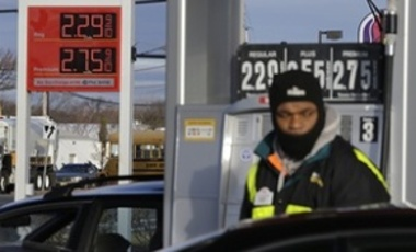 In this Dec. 12, 2014 file photo, a worker pumps gas into a vehicle in Neptune, N.J. Lawmakers are homing in on an increase in taxes to pay for transportation projects. There's just one problem: voters say they don't want higher taxes.