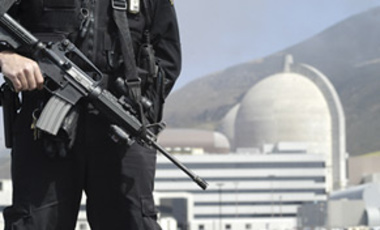 A nuclear security officer armed with an AR-15 assault rifle and 9mm hand gun patrols the coastal area of the Diablo Canyon nuclear power plant, May 5, 2004, in Avila Beach, Calif.