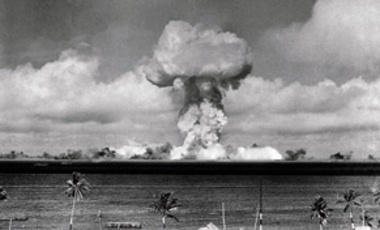 "The mushroom cloud of an atom bomb rises among abandoned ships in Bikini lagoon on July 1, 1946 after the bomb was dropped from the Super Fortress ""Dave's Dream."" This photo was made from a tower on the Bikini Island by a remote control camera automatical"