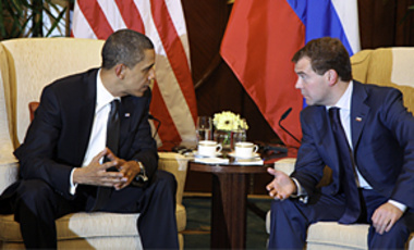U.S. President Barack Obama speaks with his Russian counterpart Dmitry Medvedev on Nov. 15, 2009. Obama said the U.S. and Russia would have a replacement treaty on reducing nuclear arms ready for approval by year's end.