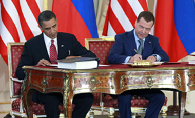 President Barack Obama, left, and Russian President Dmitry Medvedev sign the New START treaty at the Prague Castle, April 8, 2010. Obama warned that failure to ratify a new arms control treaty with Russia would undercut U.S. leadership on many challenges.