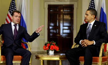 Russian President Dmitry Medvedev, (L), gestures as U.S. President Barack Obama listens to him during their meeting ahead of the G20 summit in London, April 1, 2009.
