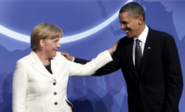 President Barack Obama greets German Chancellor Angela Merkel during the official arrivals for the Nuclear Security Summit in Washington, April 12, 2010.