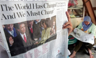 An Indonesian Muslim woman reads a newspaper bearing the inauguration of U.S. President-elect Barack Obama on its cover in Jakarta, Indonesia, Jan. 21, 2009.