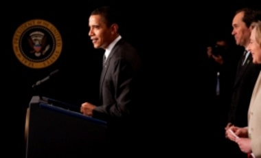 President Barack Obama shares the podium with MIT's Susan Hockfield and Paul Holland of Serious Materials during the President's remarks on investments in clean energy and new technology, March 23, 2009, in the Eisenhower Executive Office Building.