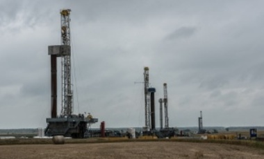 Fracking oil rig drills in an Oklahoma field.