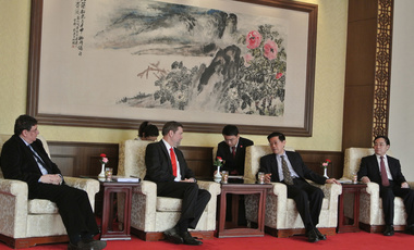 Harvard Kennedy School's Tony Saich and Dean David Ellwood at a formal meeting with Li Wei, director of the Development Research Council, and Wang Jingqing, vice minister of the Organization Department of the Peoples Republic of China.