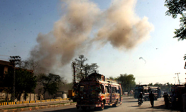 Smoke rises after a suicide bombing near the U.S. consulate in Peshawar, Pakistan, on Apr. 5, 2010. The U.S. consulate was attacked with car bombs and grenades,  killing 3 people.
