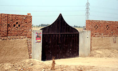 The main gate of a compound run by the al-Qaida linked terror network Jaish-e-Mohammed, in southern Punjab, Pakistan, Mar. 20, 2009. Officials say Jaish and other groups in Punjab send fighters to Afghanistan and the frontier region.