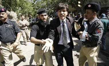 Police take away lawyers during an anti-President Pervez Musharraf protest in Karachi, Pakistan, on Feb. 21, 2008.