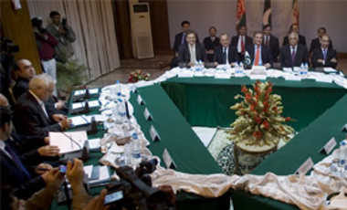 Foreign ministry officials from Iran, right, Afghanistan, left, and Pakistan, center, attend a meeting in Islamabad, Pakistan, Jan. 16, 2010. They were meeting to discuss a range of issues: extremism, terrorism, & bilateral and regional security matters.