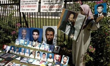 Photos of missing people are displayed outside the Supreme Court building in Islamabad on Oct 4, 2007. Dozens gathered and demanded to be told of the whereabouts of their missing family members allegedly detained by the state's intelligence agency.