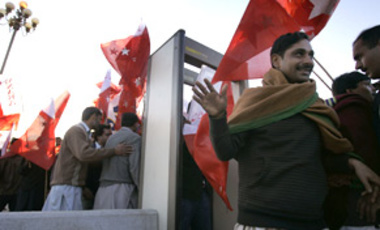 Supporters of Pakistan's President Pervez Musharraf pass through metal detectors to join a rally for the ruling party in Islamabad, Pakistan, Feb. 11, 2008.