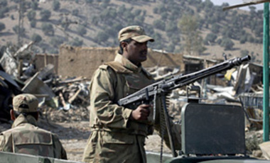 Nov. 17, 2009: Pakistani army troops patrol in a damaged market in Sararogha, in the Pakistani tribal region of South Waziristan along the Afghan border.