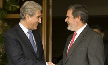 U.S. Assistant Secretary of State Richard Boucher, right, shakes hands with Pakistan's Foreign Minister Shah Mehmood Qureshi during their meeting in Islamabad, Pakistan on Wednesday, July, 2, 2008.