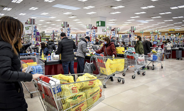 People crowd a supermarket in Milan, Italy, on March 8 after the country announced a sweeping quarantine.