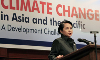 Philippine President Gloria Macapagal Arroyo speaks at the High-Level Dialogue on Climate Change, June 17, 2009, at the Asian Development Bank in the Philippines. The bank pledged to double its clean energy investments in the region to $2 billion yearly.