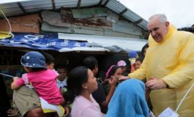 "Pope Francis visits the Typhoon Yolanda victims in one of the areas in Palo, Leyte, the Philippines, Jan. 17, 2015. Pope Francis' encyclical, ""Laudato Si,"" discussed how the effects of climate change disproportionately harm the poor."