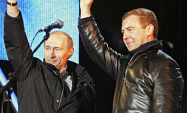 Vladimir Putin, left, and his hand-picked successor Dmitry Medvedev wave to their supporters in Moscow's Red Square on March 2, 2008.