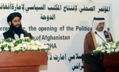 Qatari Assistant Minister for Foreign Affairs Ali bin Fahd al-Hajri, right, & Muhammad Naeem, representing the Taliban, at a press conference at the official opening of the Taliban office in Doha, Qatar, June 18, 2013