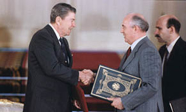 President Reagan and Soviet General Secretary Gorbachev shake hands after signing the INF Treaty.