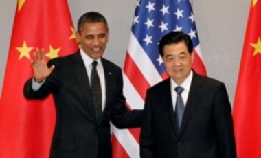 In this March 26, 2012, file photo President Barack Obama, left, greets Chinese President Hu Jintao at the start of their bilateral meeting in Seoul, South Korea.